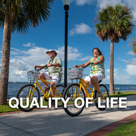 Punta Gorda Quality of Life button - couple on bikes by waterfront