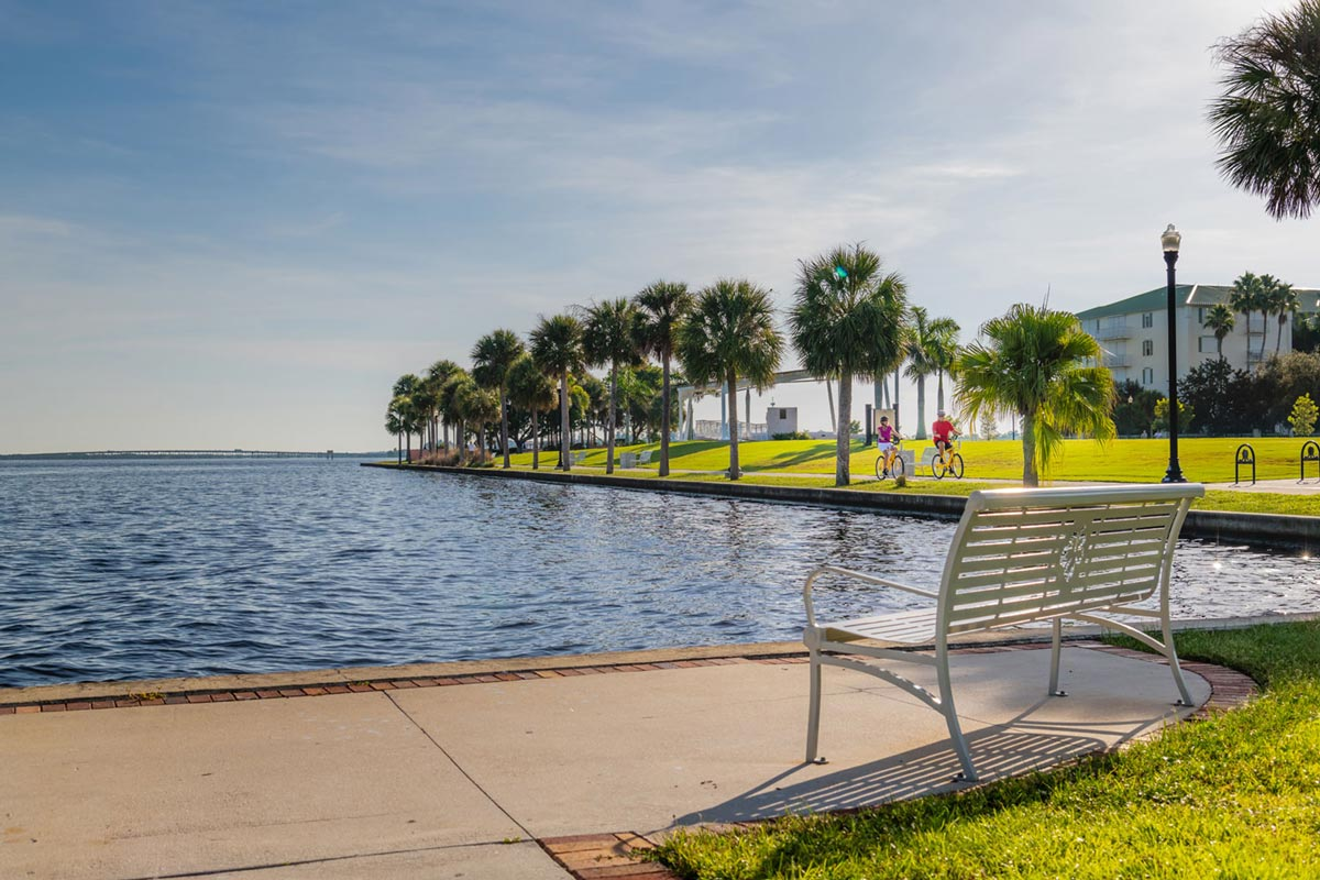 Punta Gorda Couple Biking by Waterfront