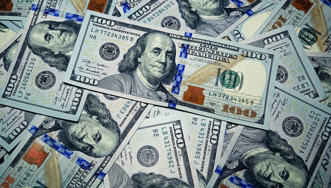 image of pile of 100 dollar bills